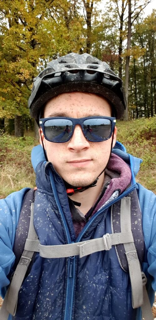 A selfie of me, muddied after driving a bike